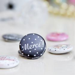 Button Merci
